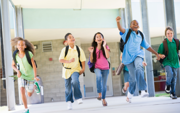 Unfortunately, for obvious reasons, I'm not able to take pictures of the students myself, so here's a stock photo of other happy kids!